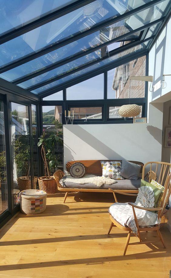 sun room, wooden foor, wooden chair, wooden sofa with grey cushion