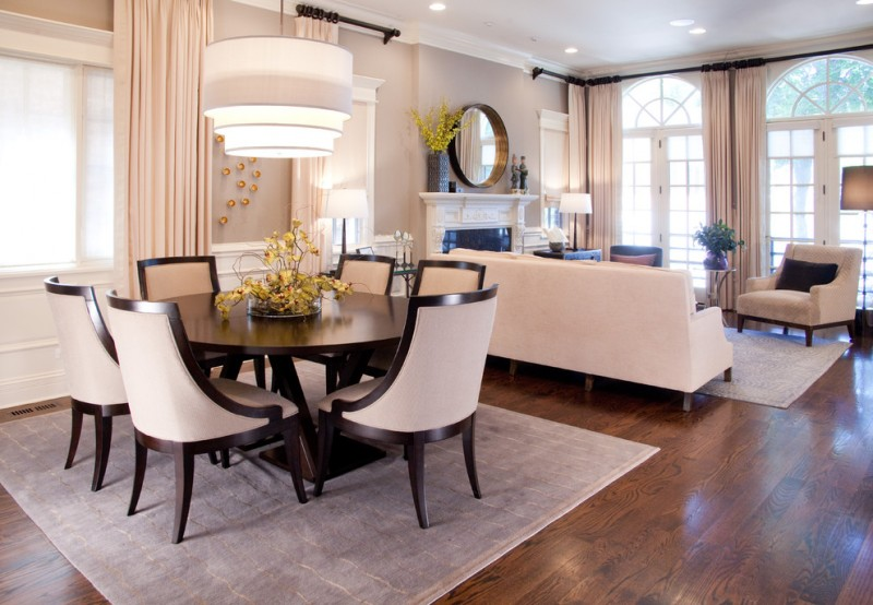 transitional dining room sets chandelier beige curtains windows french door wall mirror wooden floor round table chairs fireplace floor lamp