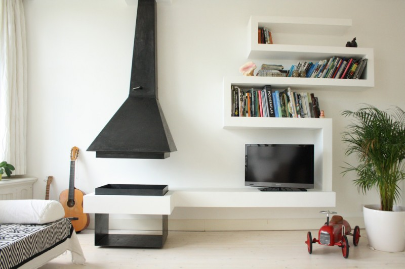 unique bookcase black range hood white bookcase infoor plant white wall fire pit bench day bed floor tile white curtain