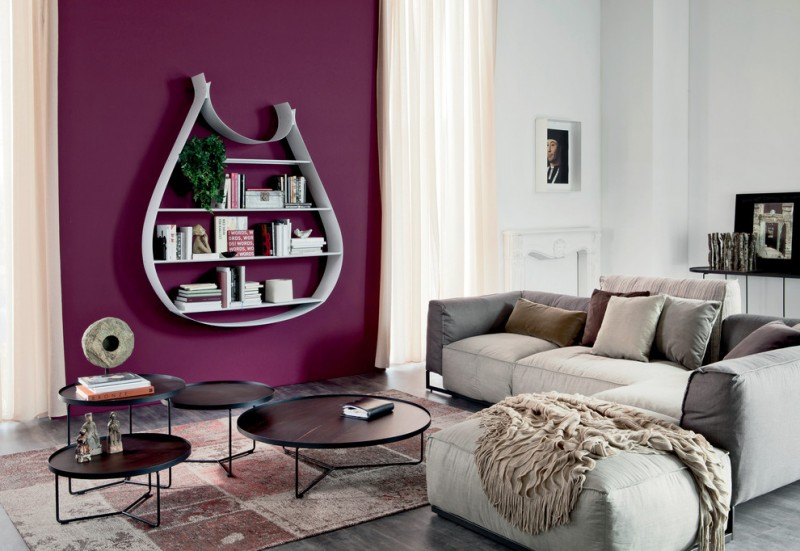 unique bookcase purple wall black nesting coffee table gray couch throw beige curtains brown pillows white walls windows