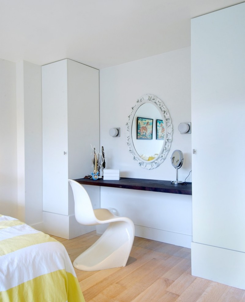 vanity chair antique white framed wall mirror wooden floor black mounted table wall sconces make up mirror white phantom chair white walls