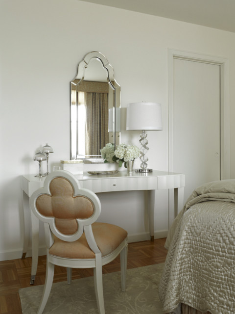 vanity chair wall mirror white shade glass table lamp white wall brown rug wooden floor clover chair white vanity drawer