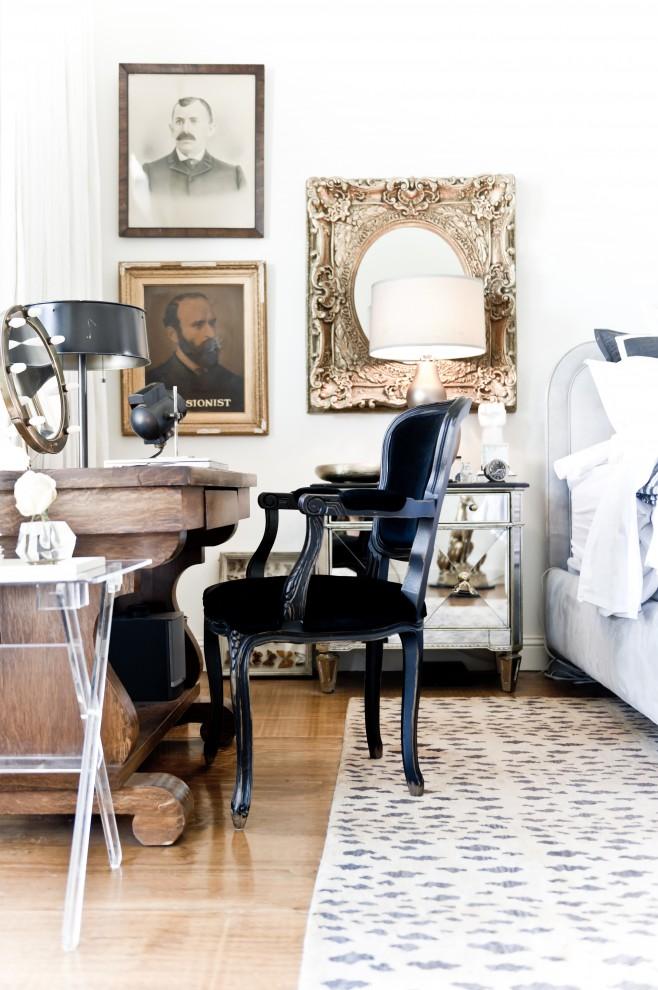 vintage bedroom vanity white wall bed headboard black vanity chair area rug mirrored nightstand vanity mirror with lighting black table lamp acrylic side table wall mirror
