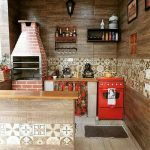 Warm Kitchen With Wooden And Tiles Combination On The Wall, Kitchen Sounter With Red Stove, Small Island With Wooden Top, Wood And Tiles Under