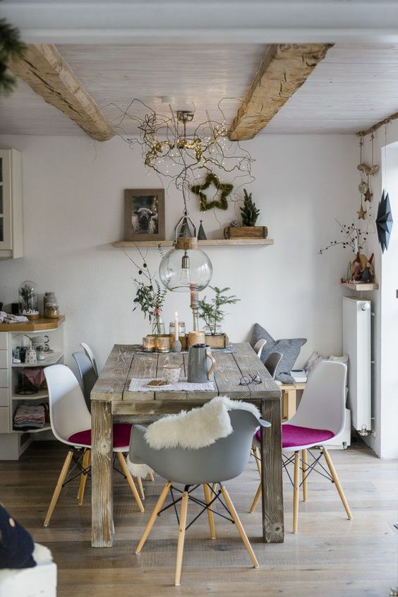 white and grey mid century modern chairs, wooden table, white wall, white wooden ceiling with beams, wooden floor, white shelves
