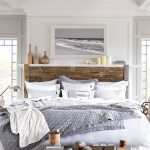 White Bedroom Decorating Ideas Gray Artwork Wooden Headboard White Bedding Gray Blanket White Rug Wooden Floor Table Lamp Windows