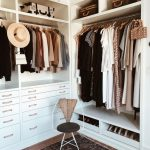 White Built In Wooden Walking Closet With Shelves, Rail, Drawers, Wooden Floor, Rug, Cahair