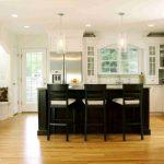 White Cabinet With Glass Door Black Island Black Barstools Glass Pendant Lamps French Window Green Backsplash Refrigerator Sink Stovetop