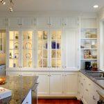 White Cabinet With Glass Door Cabinet Lighting Granite Countertop Glass Windows Range Hood Stove Double Sink White Shelves