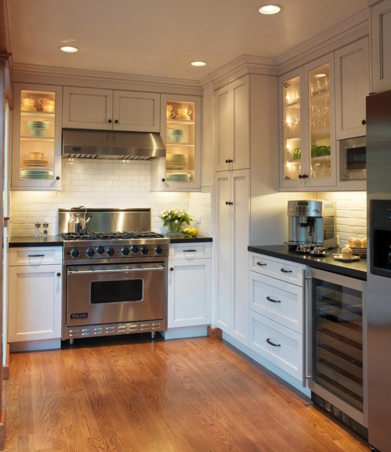 white cabinet with glass door cabinet lighting oven stove rangehood wooden floor drawer refrigerator wine cellar white subway backsplash
