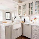 White Cabinet With Glass Door Dishwasher Farmhouse Sink Mediterranean Kitchen Rug Windows White Backsplash White Countertop Faucet
