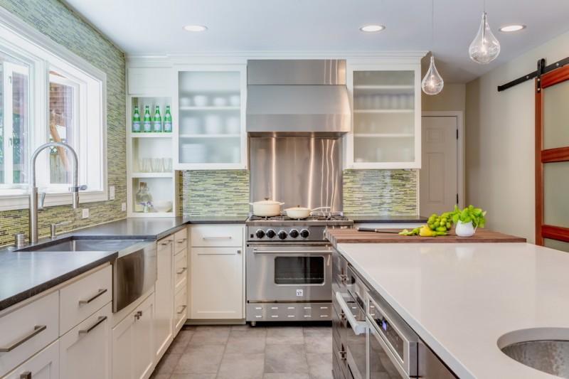 white cabinet with glass door frosted glass doors stainless steel sink islna dwhite countertop dishwasher glass pendant lamps mosaic backsplash white shelves windows