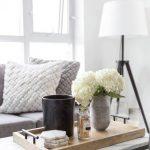 White Marble Coffee Table, Wooden Tray, Grey Sofa, Pillows, White Floor Lamp