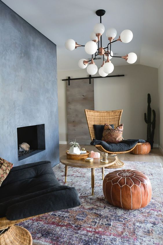 white modern bulbs chandelier, grey wall, beige wall, rattan chairs with black cushion, round coffee table, leather ottoman