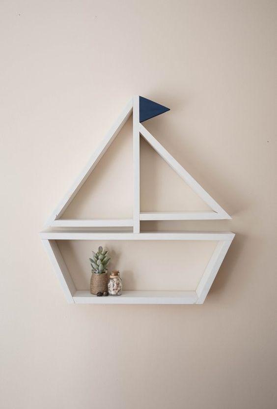 white wooden floating shelves shaped like a sailboat