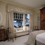 Window Seats Beige Decorative Valance Beige Curtains Striped Cushion Glass Bay Windows Round Window Chairs Wooden Dresser Wooden Cupboard Pillows Decorative Bedding