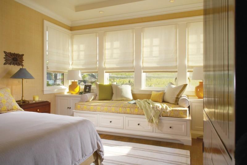 window seats white shades windows white drawers white cabinets table lamps white bedding pillows white rug yellow cushion