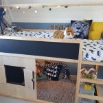 Wooden Bunk Bed With Black Boards On Upper Bed And Wooden Frame, Toys Room Under