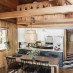Wooden Cabin, Kitchen, Wooden Floor, Wooden Wall And Ceiling, Black Cabinet And Island, Hite Upper Cabinet, Wooden Table, Black Chairs, Rattan Pendant, Black White Kitchen Floor