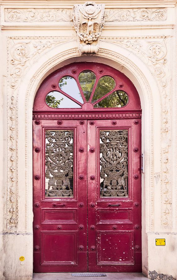 antique doors, pink glossy paint, hal round windows, white detailed wall