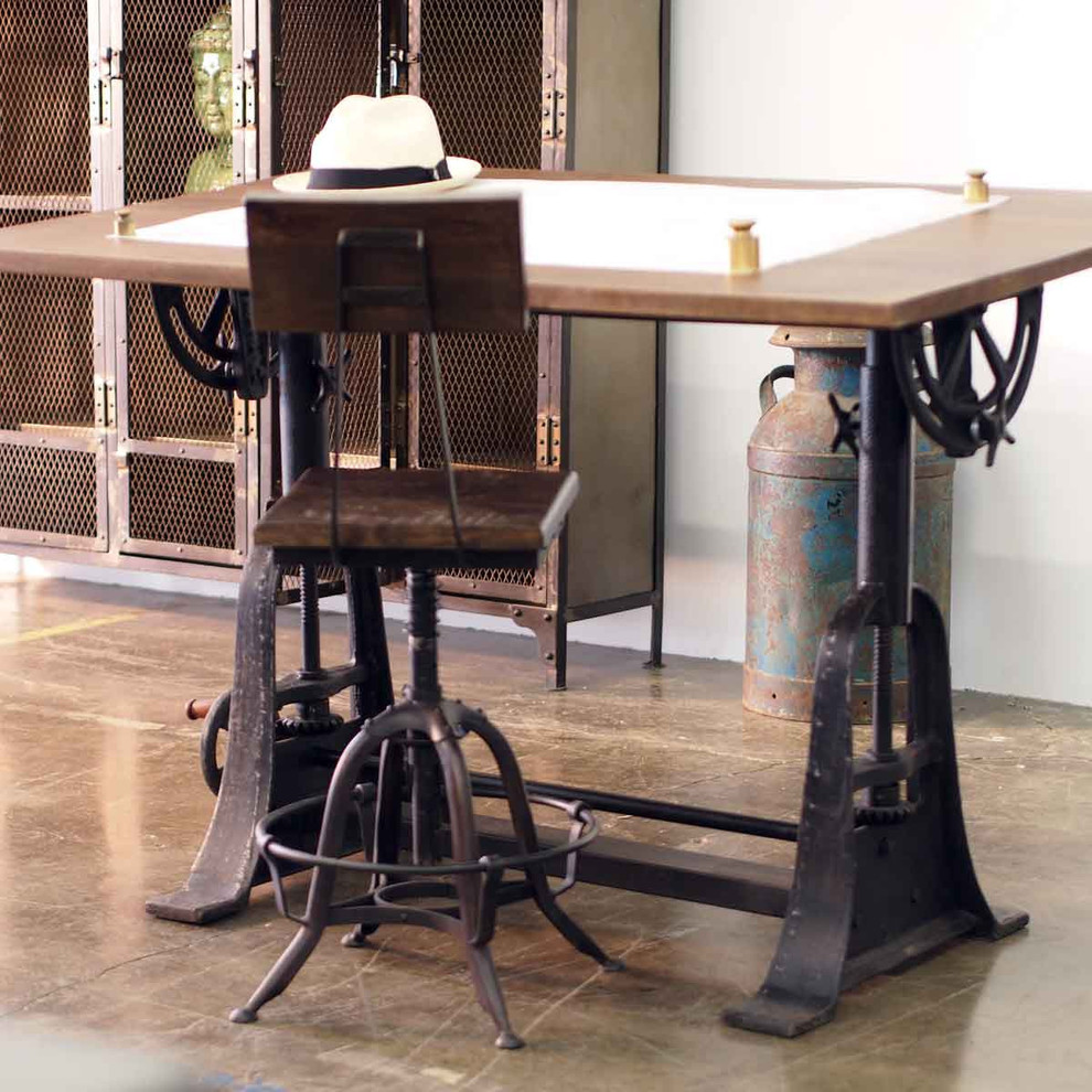 antique drafting table industrial drafting table floor tile rustic metal cupboard wired doors small indutrial chair head statue white wall