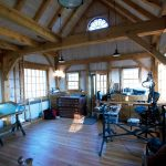 Antique Drafting Table Windows Wood Beams Black Industrial Pendant Lamps Wooden Drawers Wooden Floor Black Office Chair Table Lamp Door