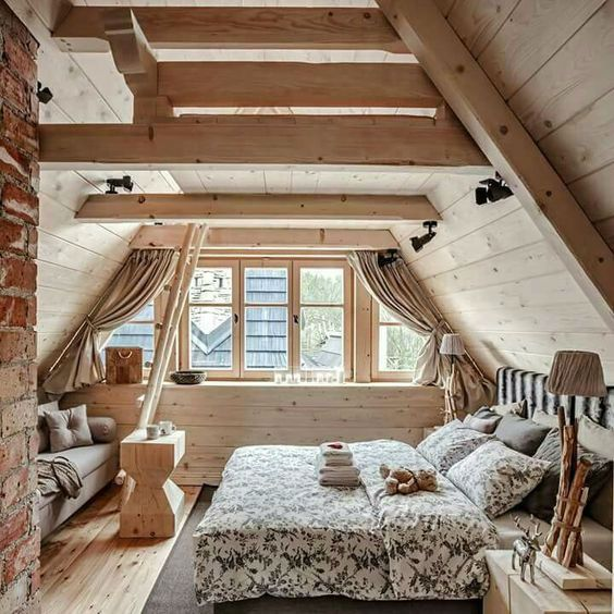attic bedroom, wooden floor, grey rug, ebd, grey sofa, coffee table, wooden sloping wall, stair, wooden side table