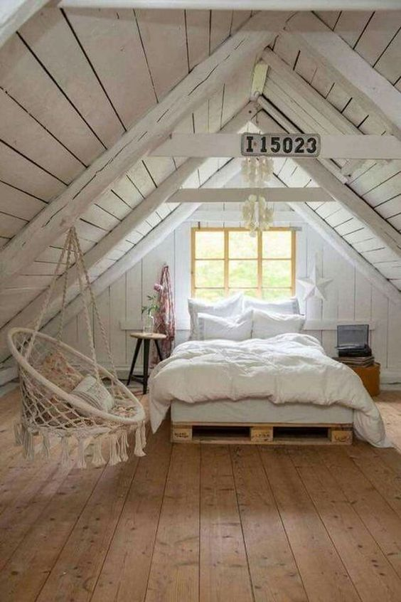attic bedroom, wooden floor, white wooden ceiling, window, bed with wooden crate platform, bohemian swing