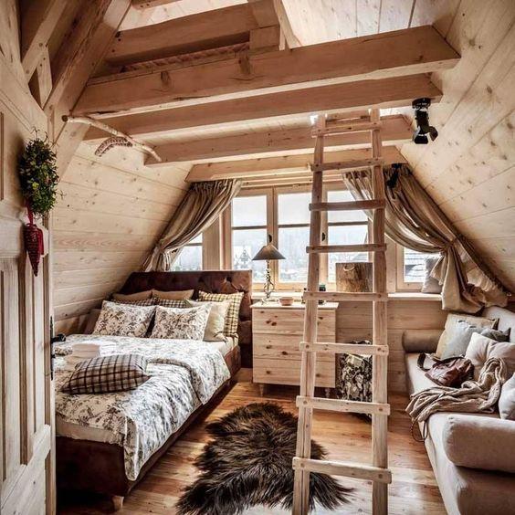 attic bedroom, wooden floor, wooden sloping wall, stair, bed, sofa, wooden cabinet, window