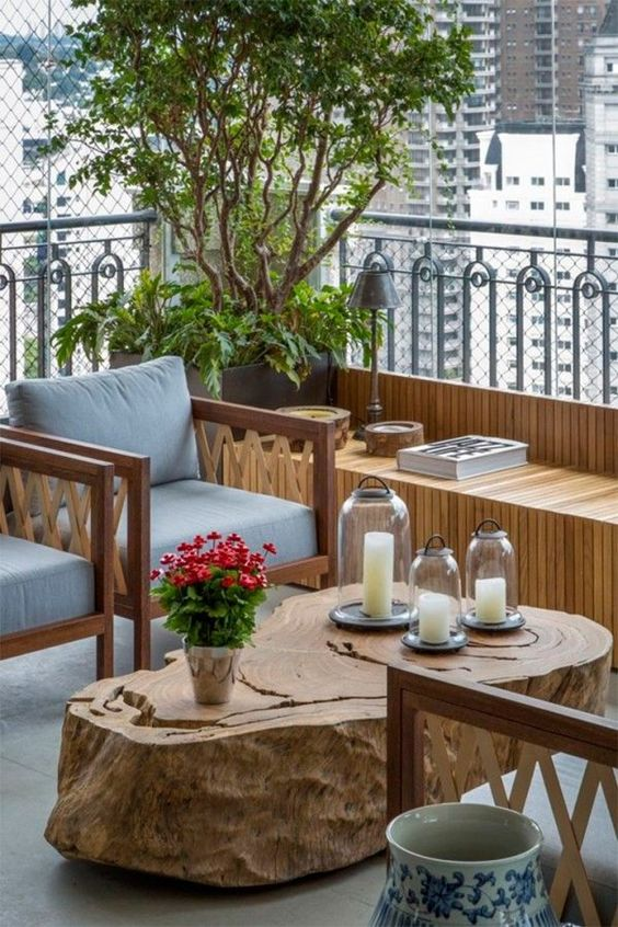 balcony, grey wooden floor, wooden chairs with grey cushion and back, wooden slab coffee table, wooden bench along the fence