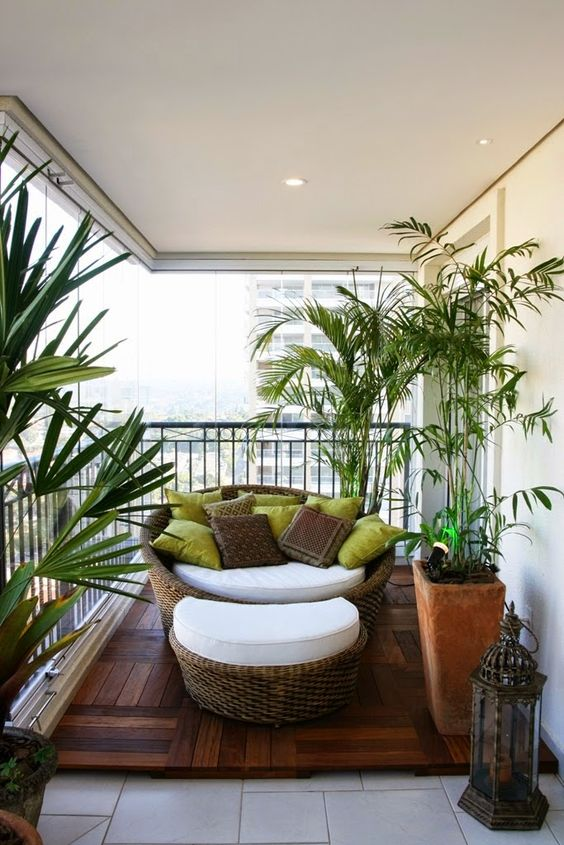 balcony, white floor tiles, wooden floor, white wall, rattan lounge chair with white cushion, rattan ottoman with white cushion