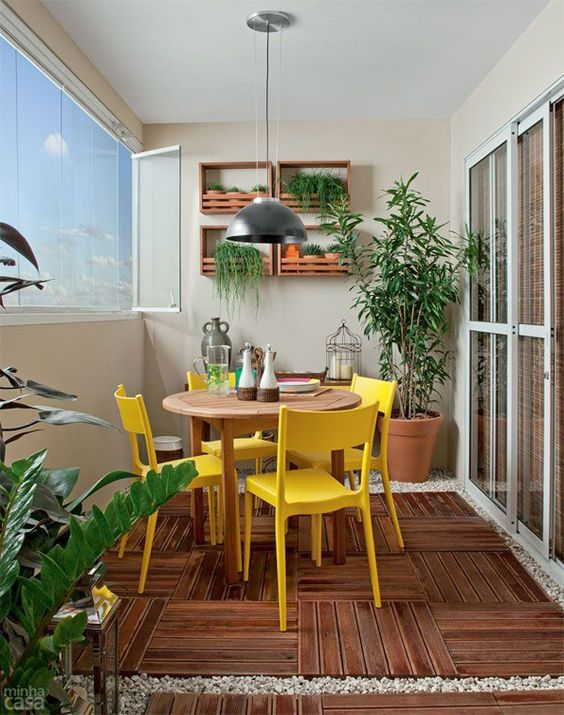 balcony, wooden weave floor, beige wall and ceiling, wooden round table, yellow chairs, silver pendant, glass sliding door, glass window