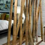 Bamboo Divider With White River Stone And Wooden Tray At The Bottom, Grey Wall, White Bedding