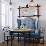 Banquette, Blue Leather Sofa With Tall Back, Black Metal Chair, Wooden Round Table, White Wall, Clear Bulb Pendants