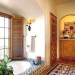 Bathroom, Brown Floor, Colored Patterned Rug, Blue Patterned Tub With White Inside, White Wall, Arch Ceiling, Wooden Windows, Wooden Cabinet