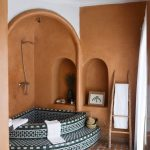Bathroom, Brown Wall, Brown Arch, White Ceiling, Blue Patterned Corner Round Tub, Brown Floor