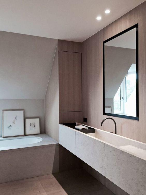 bathroom, grey bath tub, grey floating floating, black faucet, brown wall, round tub