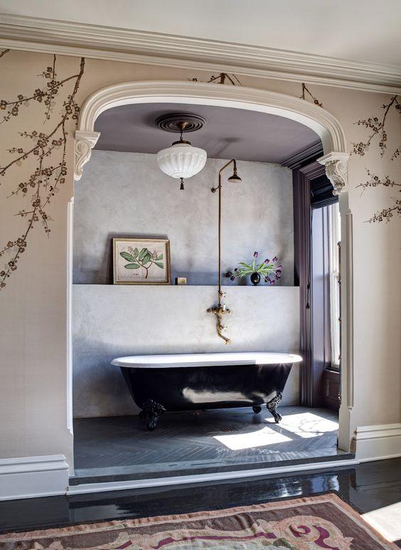 bathroom, grey chevron floor, grey wall, grey ceiling, beige wall with flowers, white chandelier,