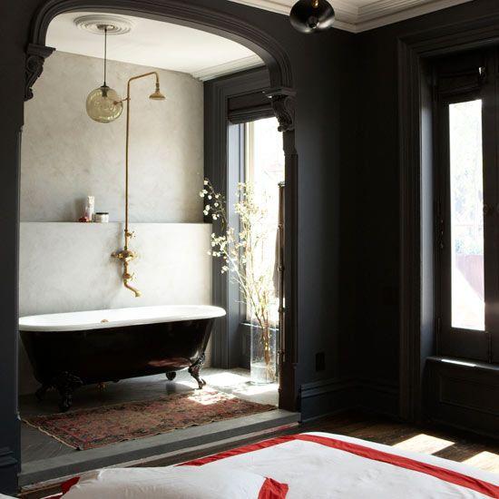 bathroom, grey floor, grey wall, clear glass pendant, black wall