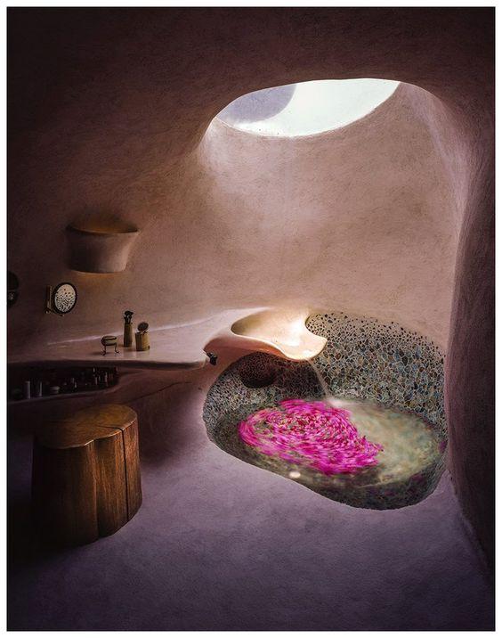 bathroom, pink wall, pink floor, pink floating vanity, wooden stool, round deep tub