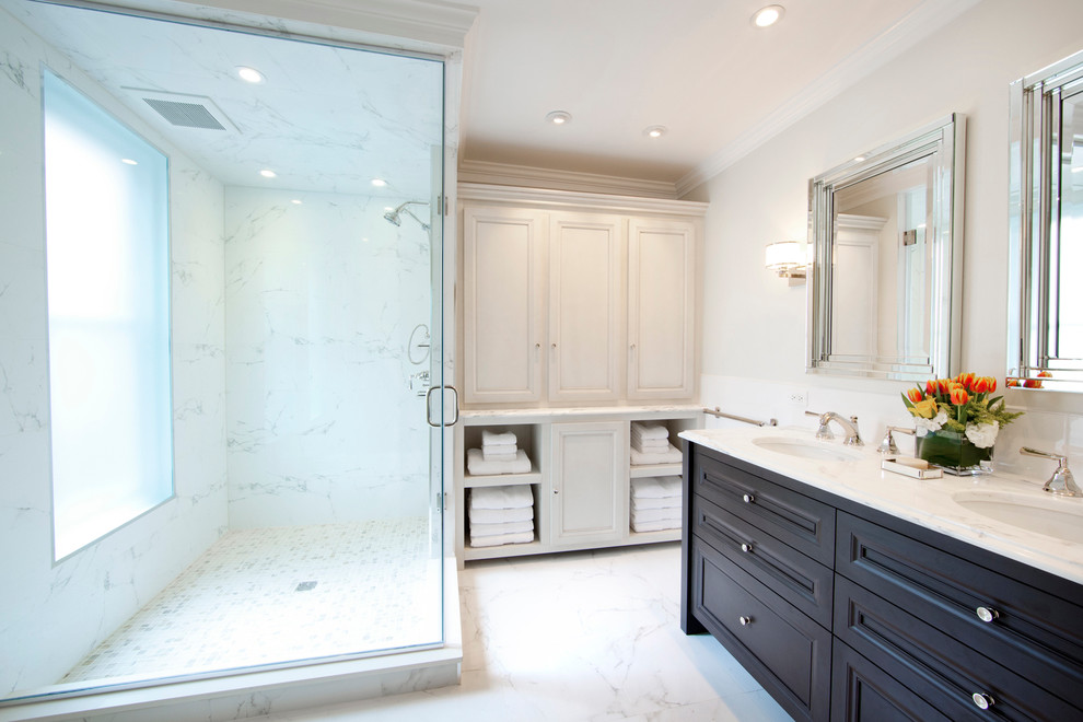 bathroom storage cabinets glass shower door frosted glass door wall mirrors black vanity double sink faucet shelves marble walls wall sconces