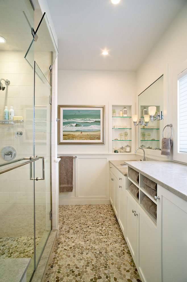 bathroom storage cabinets glass shower doors mosaic floor tile white cabinet white vanity undermount sink wall mirrors glass built in shelves window shutter gray countertop