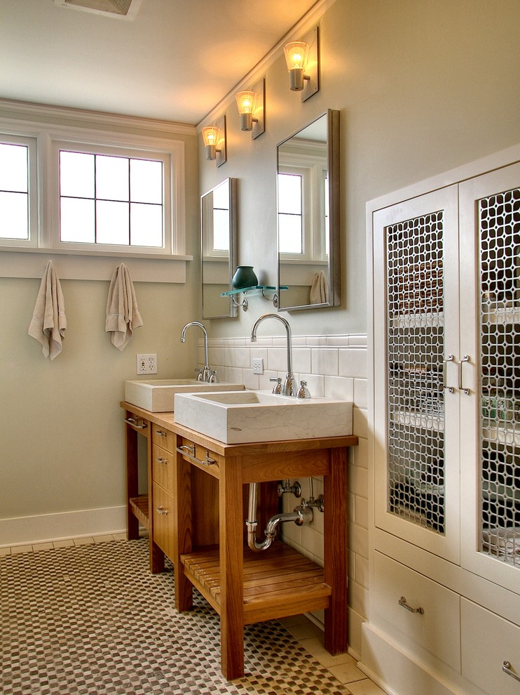 bathroom storage cabinets wall mirrors wall sconces built in cabinet subway wall tile patterned bathroom mat wooden vanities sink bowls faucet windows hand towel hooks glas