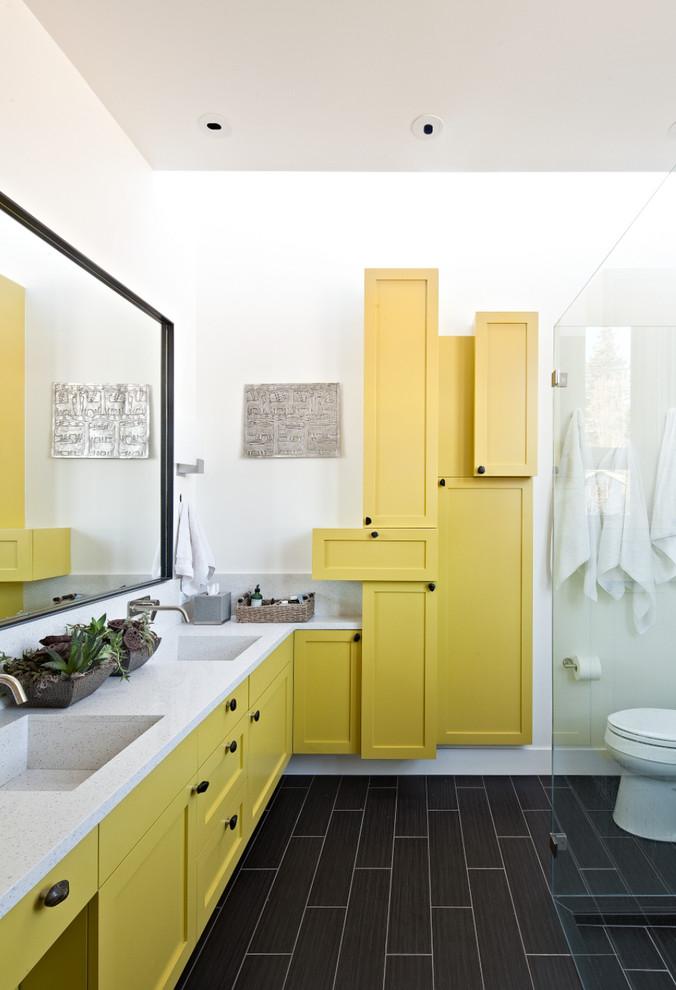 bathroom storage cabinets yellow cabinet yellow floating vanity white countertop glass shower door wall mirror double sink wall mounted faucets dark floor tile toilet