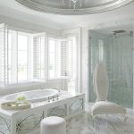 Bathroom, White Marble Floor, White Wall, White Marble Tub, White Chair, White Ottoman, White Ceiling, Silver Round Indented Ceiling, Chandelier, Shower Room
