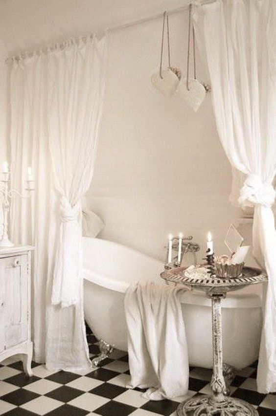 bathroom, with black and white checkered floor, white wall, white curtain, white tub, white wooden cabinet, round tray table