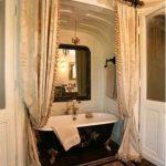 Bathroom, Wooden Floor, White Wall, White Arch, Black Tub, Golden Curtain On Black Rod, Black Mat