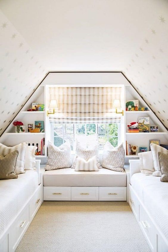 bedroom, brown rug, white ceiling with golden stars, white wooden paltform with drawers, white cushion, white bench, window, white built in shelves, striped curtain