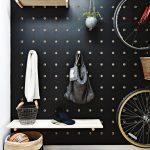 Black Pegboard Wall, White Shelves, Wooden Floor, Wooden Hooks