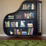Black Wooden Bookshelves In The Shape Of Piano, Wooden Floor, Green Rug